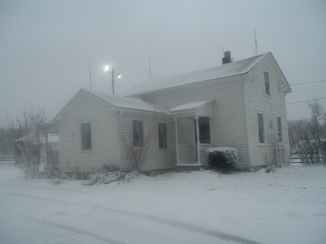 Stearns house covered in snow